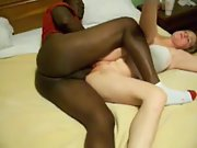 Interracial couple having missionary sex in bed